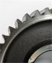 Different conditions of first gear: a) healthy; b) wear in gear; c) broken gear