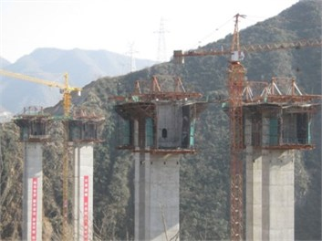 Photos of a pre-stressed concrete Rigid Frame Bridge during different construction stage:  a) the zero block construction stage, b) the closure up construction stage of the main span