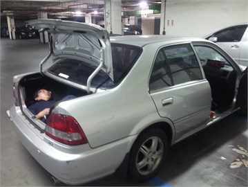 A person hiding in the trunk of the car