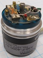 First modification of piezoelectric high resolution rotary table: a) photoelectric angular position encoder A36-F-4000-5V, b) rotating part, c) optimisation scheme for contact element trajectories :  1 – rotating part, 2 – precise ring, 3 – piezoelectric multilayer plate,  4 – contacting elements, 5 – spring, 6 – sectioned electrodes;  resonant frequency – 75.2kHz, harmonic excitation amplitude – 10V