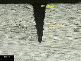 Results of laser-drilled holes with and without vibration of 40W laser:  a) without vibration; b) –180° phase lag synchronization; c) 0° phase synchronization