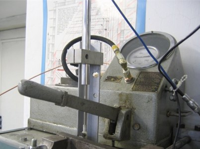 View of laboratory test stand and hydraulic pump