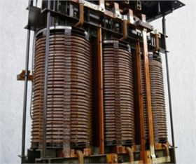 a) Active part of the transformer used for the experimental tests  and b) top two discs of the winding lowered