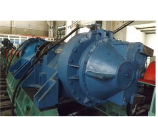 a) FL600 wind turbine gearbox, b) the internal structure of the gearbox