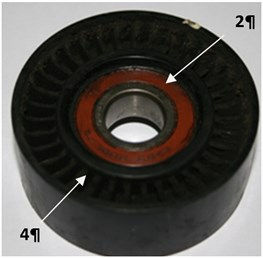 Image ball rolling bearings and drive belt tensioning rollers (4) of a car engine timing:  a) bearing a new one, b), c) bearings on exploitation 2 and 3
