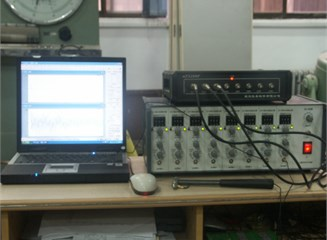a) Dynamic testing set-up and b) data acquisition system