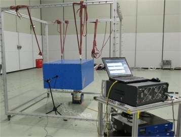 a) The phononic crystal cavity specimen consists of acceleration sensor, phononic crystals  and exciter, b) the phononic crystal cavity in free standing hanging with rubber rope  and LMS signal acquisition system