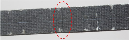 Experimental setup: a) local beam segment containing a crack as marked by ellipse; and b) SLV