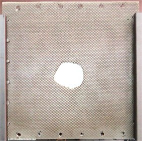 Overall view and magnification of the tested plate