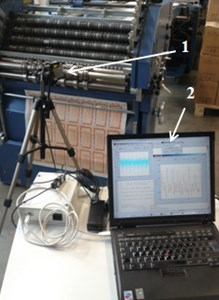 """View of equipment used for the investigations:  1 – laser head for measurement of displacements """"Microtrack LTC 200-100""""; 2 – computer"""