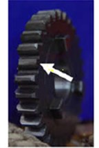 a) Broken-tooth gear, b) Slight-worn gear [18]