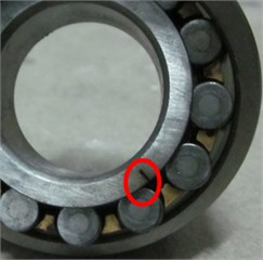 View of spherical roller bearing in normal and three faults conditions