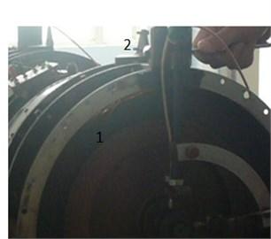Turbine casing rubbing experiment: 1 – rubbing spark, 2 – adjusting rubbing  screw against rubbing ring