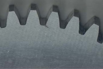 Artificially induced gear tooth root cracks: a) 2 mm; b) 4 mm