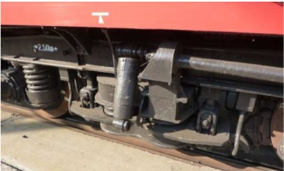 a) Goods wagon bogie with removed springs on one side and  b) passenger car running gear with secondary suspension damper disconnected
