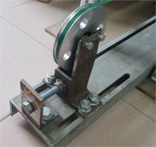 The tension adjustment mechanism