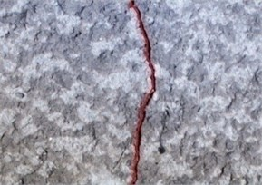 Crack detection on the wall surface: a) input image, b) detected crack