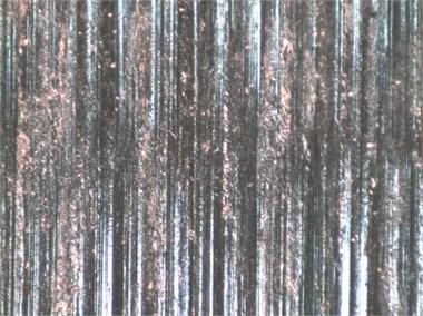 Worn surface morphologies of original sample and carburized sample under different load