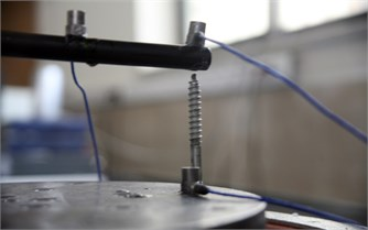A bolt was installed on the vibration table  for the vibrating pipe