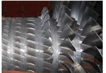 a) Ten-step compressor, b) fracture and wear of compressor blades
