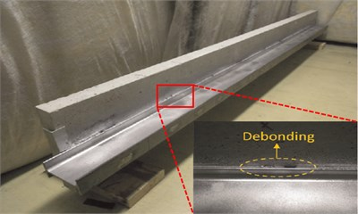 Steel-reinforced concrete slab with zoomed-in view of debonding