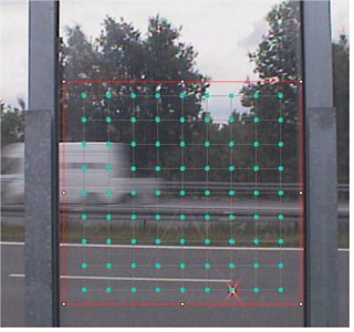 """a) Panel of noise barrier with measurement lattice on LDV screen captured during """"in situ"""" measurements of vibrations, and b) an example of the road noise barrier panel vibrations  obtained by author for frequency 0.75 Hz"""