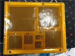 Several rectangular coils equipped with sound enclosures in rectangular boxes also