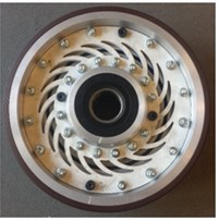 Wheel with the vibration damping system: a) components: 1 – inner bush, 2 – outer tyre,  3 – webbing, 4 – bearing assembly, 5 – outer wheel raceway polymer material,  6 – thin resilient bush, b) an assembled wheel with the vibration damping system