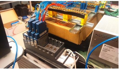 a) TECs and thermocouples wiring connected to the control module;  b) NI's modules that generate PWM signals