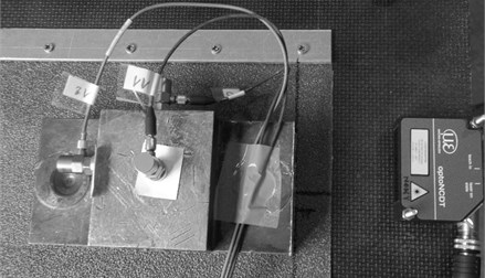 PCB accelerometers and laser displacement sensor for measuring the dynamic motion of the block