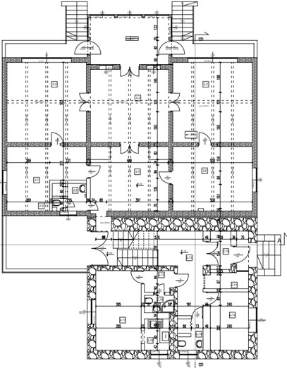 a) Front facade of evaluated building, b) plan of evaluated building