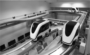 Scaled physical model of a PRT vehicle at a laboratory testing station [30]