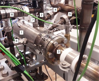 a) The prototypical microturbine installed on the test rig and b) its model showing where an accelerometer was mounted (1 – microturbine, 2 – turbine inlet, 3 – turbine outlet, 4 – bearing 1 inlet,  5– bearing 2 inlet, 6 – horizontal accelerometer, 7 – vertical accelerometer, 8 – pressure sensor)