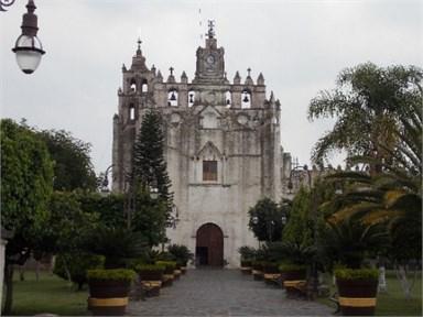 a) Main façade and b) cloister of the Atlatlahucan Ex-Convent  before September 19, 2017, earthquake
