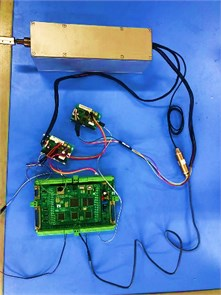 Experimental device: a) Stiffness measurement experiment with UR robot, b) the control system