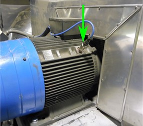 Photo of a monitored centrifugal over-hung fan with a sensor placement marked by a green arrow