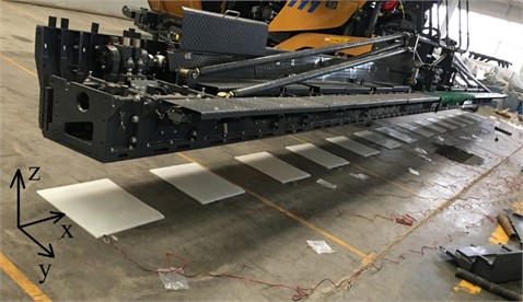 The actual structure of the asphalt paver and its experimental setup process