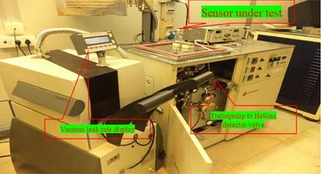 a) Vacuum leak rate test setup block diagram, b) vacuum leak rate test setup equipment